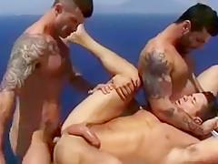 Three hunky dudes fuck outdoors